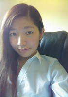 A photo of Lucy who is one of our Mandarin Chinese tutors in The Colony
